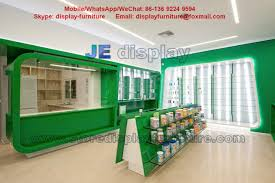 store display furniture. Health Drugs Store Display Furniture For Interior Design By Green Color Wood Cabinet And Tempered Glass Shelves