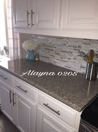 white quartz countertops. Alpina White Quartz Countertop. MS Cristallo Interlocking Glass And Marble Mosaic Back Splash. Cabinets. Countertops