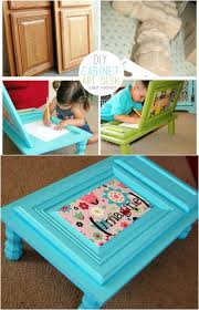 what better way to put those old cabinet doors to great use than by creating art desks for your little ones painted in bright colors and with tiny little