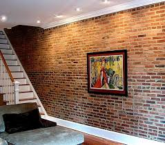 faux brick panels to get this look like to redo the wood wall down stairs