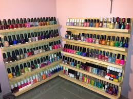 up against the wall the two nail polish racks