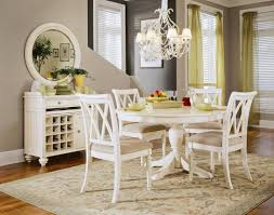 rustic modern dining room design with vintage furniture and 54 round wood pedestal dining table painted with white color and 4 chairs under hanging lamp