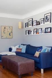 love the shelving in the living room for displaying family photos instead of