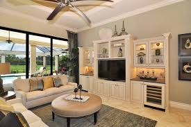 custom built entertainment center ideas living room traditional with under cabinet lighting ceiling fan beige cabinets