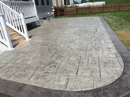 this new patio was creating using an ashlar slate stamp to achieve the desired pattern and poured concrete natural looking a22 patio