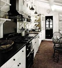 Brick Flooring For Kitchen Parisian Kitchen Design With Brick Flooring And White Cabintes And