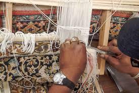 complex weaving of a fine rug in progress