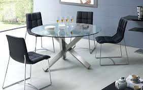 modern round glass dining table with four black chairs extendable