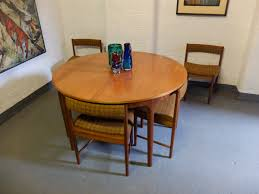 sold teak round extending dining table with 6 chairs by mcintosh