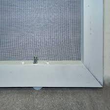 close up of light duty patio screen door plastic wheel