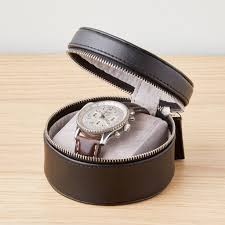 black leather watch and cufflink travel case