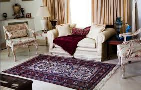 beautiful oriental rug in home near couch and formal chairs