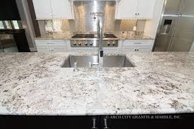 white granite with gray black and blue minerals