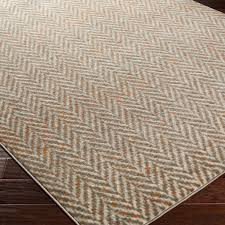 light gray olive green and burnt orange alternate in zigzags for a dimensional floor covering with endless versatility