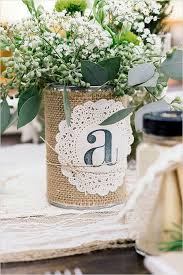 Shabby chic centerpiece, table number on can with burlap and doillie