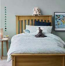 photos of bedroom furniture. Children\u0027s Bedding In A Kids\u0027 Bedroom With Wooden Bed Photos Of Furniture