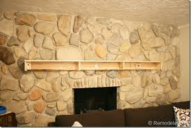 installing a wood mantel on a stone wall 66
