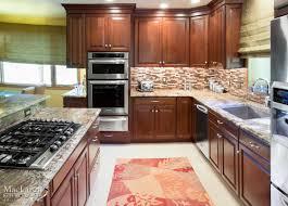 Neptune Kitchen Furniture Warm Neptune Bordeaux Granite Kitchen With Dark Cherry Cabinetry