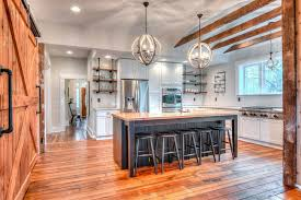 Nice Caster Connection Kitchen With Barn Door And Pipe Shelves