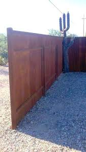 corrugated steel fence with arched gate metal and wood framed gates corrugated metal retaining wall privacy fence designs