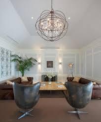 modern orb chandelier in high ceiling living room