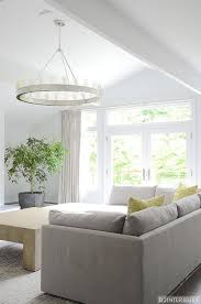 gray sofa with yellow pillows and ring chandelier