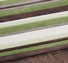 green cream and brown rugs
