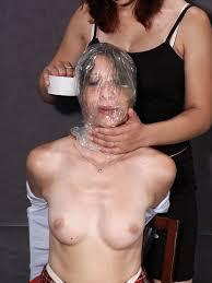 Women plastic bag bondage