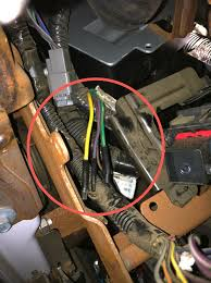 car audio tips tricks and how to s ford f series super duty you can remove the black cover to reveal the 4 auxiliary switch relays the output wires will be located below the relay pack coming out of factory black