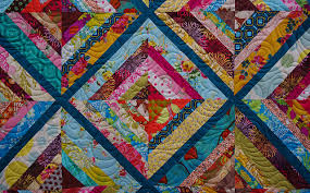 Quilts on Bastings: Kaleidoscope String Quilt & Tina on the other hand succeeded in finding the perfect backing fabric for  this String Quilt. Adamdwight.com