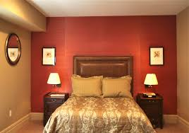 cool red wall painted color bedroom with awesome decorating red bedroom ideas with brown leather wall headboard as well as brown wood beside table and lamps