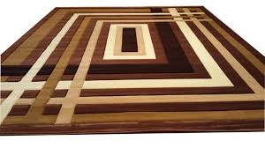 area rugs hand carved brown area rug