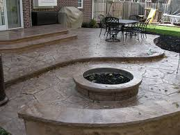 stamped concrete patio with gas fire pit