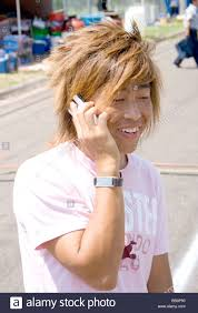 Hair Style Asian asian hmong teen with hip hair style talking on cell phone hmong 7524 by wearticles.com