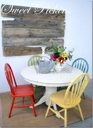 painted table and chairs love the colors muted primary would love this look for the room