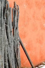 Image Vintage Background Image Of Stucco Wall With Rustic Wooden Fence Besides It Stock Photo 123rfcom Background Image Of Stucco Wall With Rustic Wooden Fence Besides