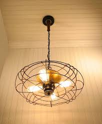 Pendant Light From Industrial Fan. Source: LampGoods, Etsy Weu0027ve Definitely  Seen Ceiling Fans With Lights, But How About A Light Fixture Made Out Of A  Fan?