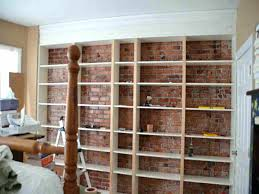 wall to wall bookshelf wall to wall shelf top brick walls top brick walls bricks walls wall to wall bookshelf
