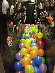 Playing on the clown theme I loaded up a 3 foot wide hallway with 200  balloons and hung clown masks painted by the 4th grade classes.