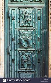 Medieval Doors detail of the bronze doors on the medieval gothic front facade of 4742 by xevi.us