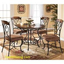 dining room table nola round table with wood top and metal pedestal base 4 side chairs by ashley