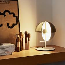 merging light and shadow our theia m table lamp was designed by mathias hahn for