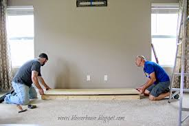 building the hearth base for faux fireplace blesser house featured on remodelaholic