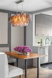 rectangular gray capiz chandelier with iron and wood table