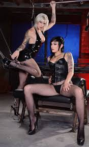 Nikki Hearts and Kleio Valentien girls in latex and leather.