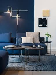 simple contemporary living room with navy blue accent wall