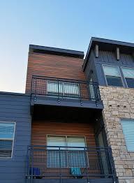 stucco vs composite wood cladding