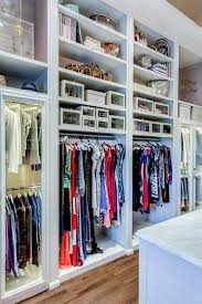 walk in closet built in shelves with custom lighting