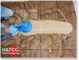 dirty tile and grout being steam cleaned