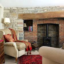 red rugs for living room natural stone living room with red rug how rugs can revitalise
